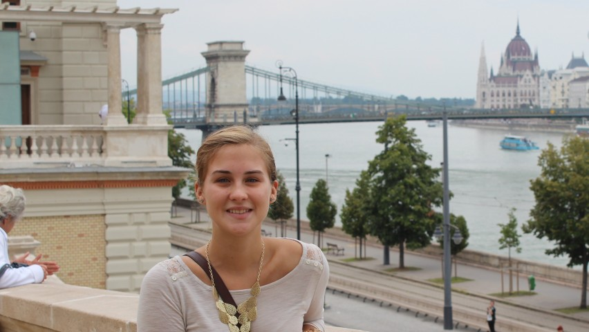 Nicole Fosko standing in front of the Danube River in Budapest, Hungary