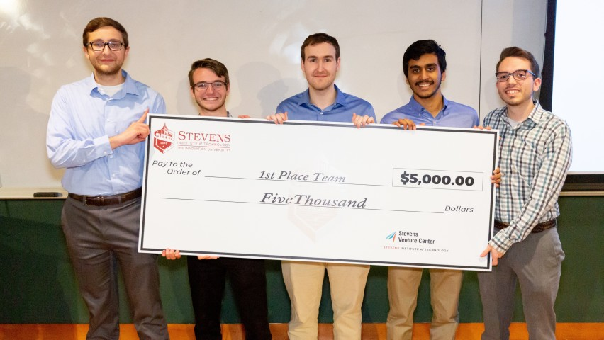 Team R3, comprised of students from Stevens, took first prize in the 2019 HealthTech Hackathon. Team members pose with a ceremonial check.