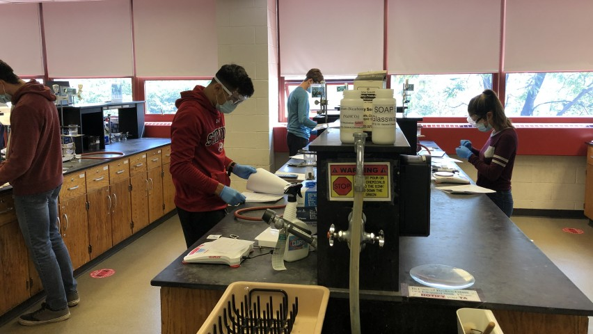 photo of students wearing PPE in the lab
