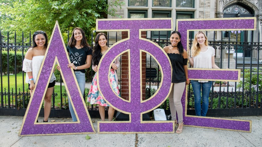 Delta Phi Epsilon puts their letters on display.