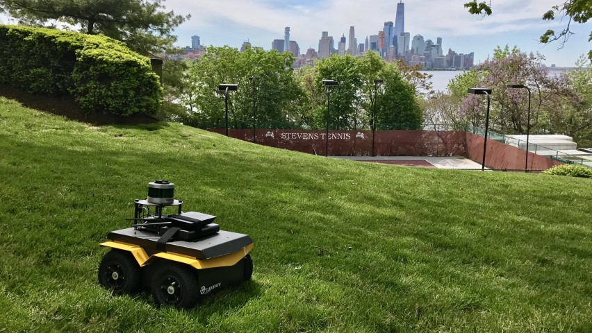 Stevens unmanned robot on top of a campus hill overlooking New York City