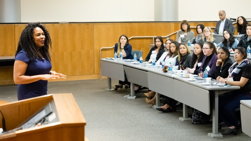 Astrophysicist Jedidah Isler speaking to an audience of mostly undergraduate and graduate women – as well as alumnae, faculty and staff.