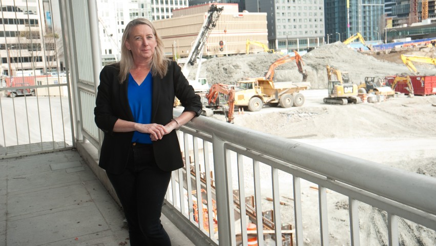 Twomey standing next to a construction site
