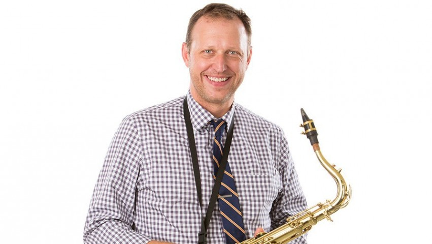 Dean Kelland Thomas featured with a saxophone.