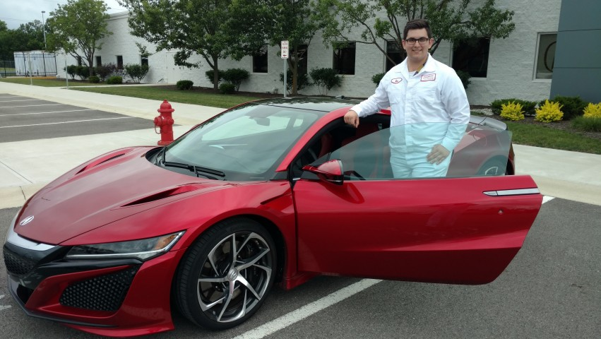 Daniel Kilgore standing in front of a red Acura NSX