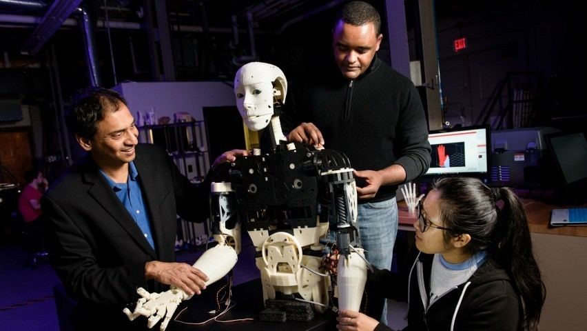 3D-printed robot with Stevens faculty, staff & student