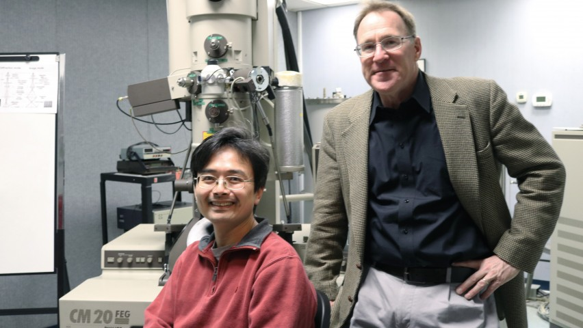 Research scientist Tsengming (Alex) Chou and professor Matthew Libera with the Philips CM20 field-emission transmission electron microscope. CREDIT: Stevens