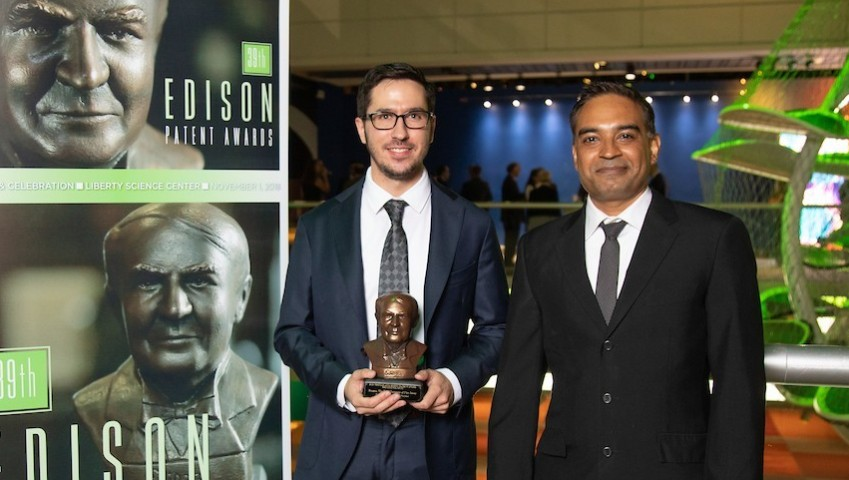 Image of Stevens alumnus Kevin Barresi and professor Mukund Iyengar receiving award