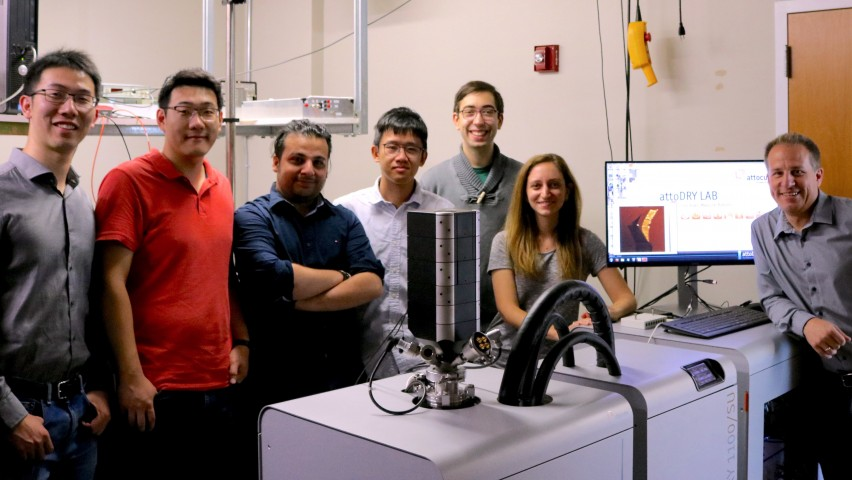 Professor Stefan Strauf and his students in the Nanophotonics Lab with the attoDRY1100