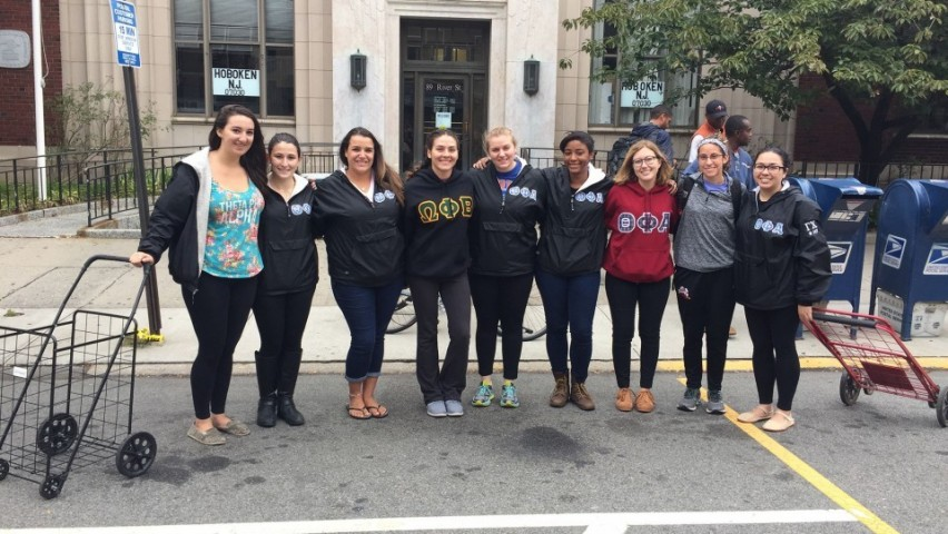 Members of Theta Phi Alpha and Omega Phi Beta sororities out in the Hoboken community to deliver food to first responders on September 29, 2016.