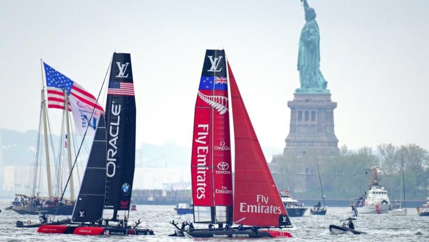 Team Oracle USA and Emirates Team New Zealand yachts near the Statue of Liberty