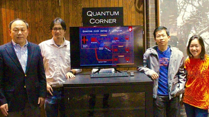 Yu and Huang with students in quantum lab