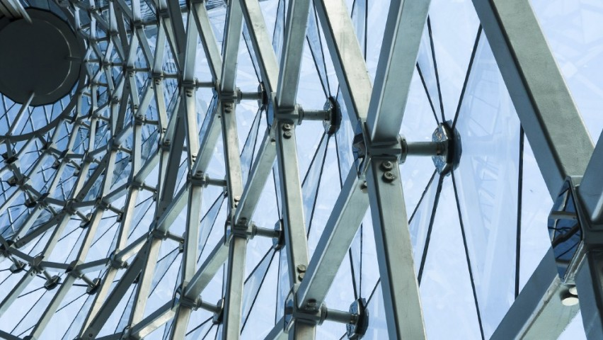 Image of glass and metal structure representative of systems