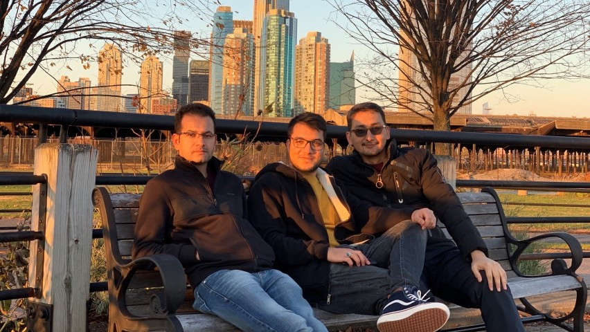 Iqbal Sadat M.S. '20, Hosam Stanikzai M.Eng. '20 and Mohammad Hassany M.S. '20 sitting on bench
