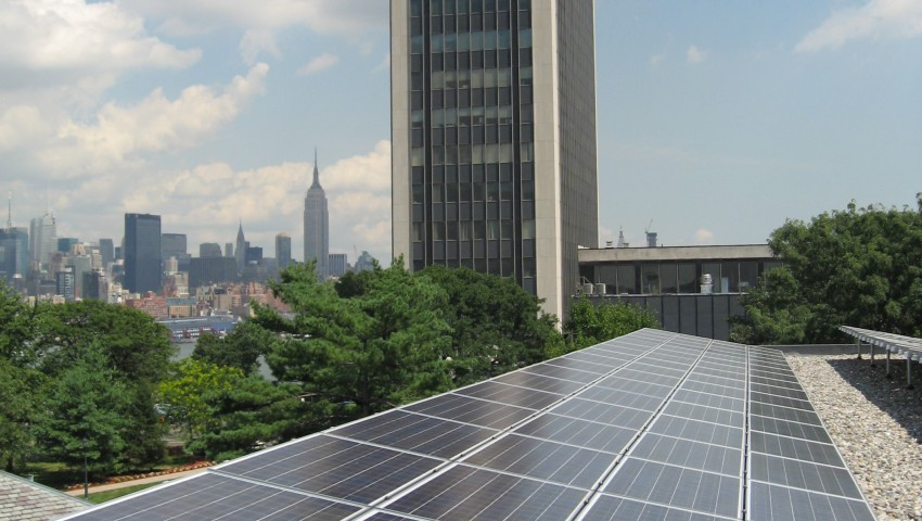 solar array on campus looking east with Manhattan with Howe Building and Manhattan in the background