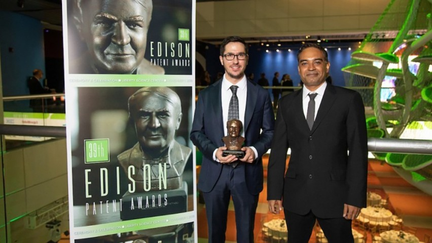 Mukund receiving an Edison award