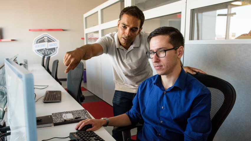 Stevens assistant professor and Entrepreneur-in-Residence Mukund Iyengar works with Keven Barresi '15, CTO of FinTech Studios, which is housed in the Stevens Venture Center.