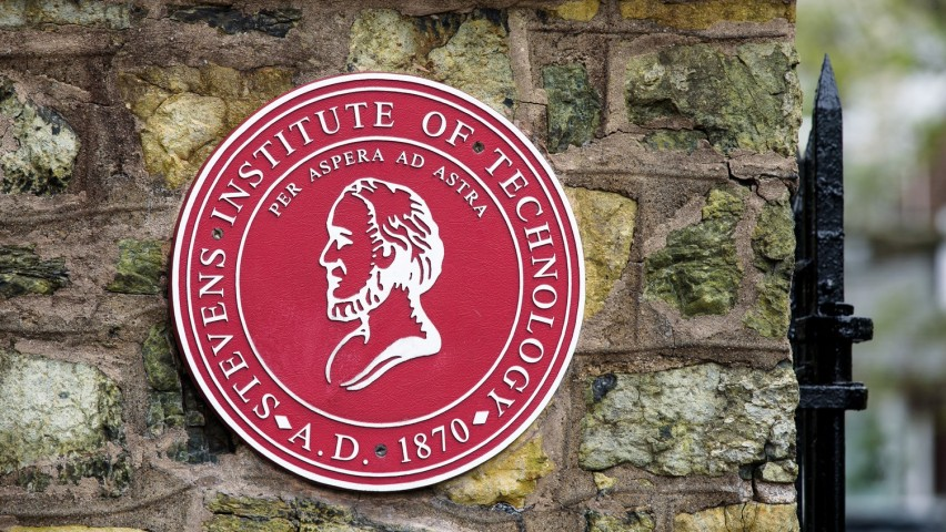 Stevens seal outside the entrance to campus