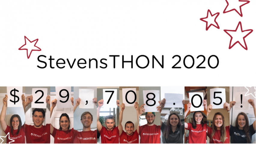 StevensTHON 2020 team hold up placards to display the total amount raised at the end of the dance marathon