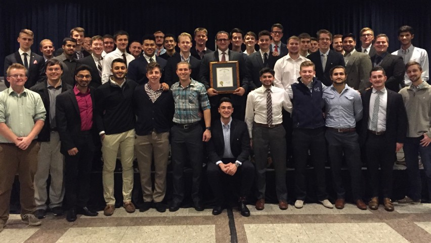Stevens undergraduate members of Theta Xi pose for a photo. Richard LoGatto, the chapter's president, stands in the center holding the All True Men certificate.