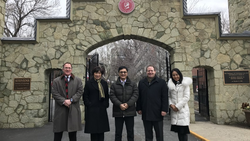 Stevens and Tsinghua Leadership Outside the Stevens Gatehouse. From Left to Right: Matt Libera, Jean Zu, Lin Zhang, Rainer Martini and Annie Song.
