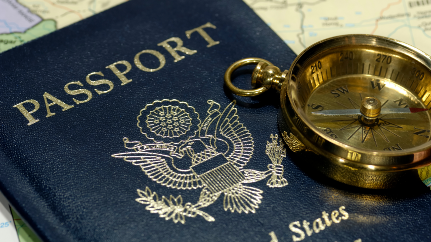 Passport, compass, and map