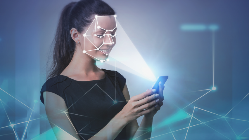 Woman holding phone showing facial recognition