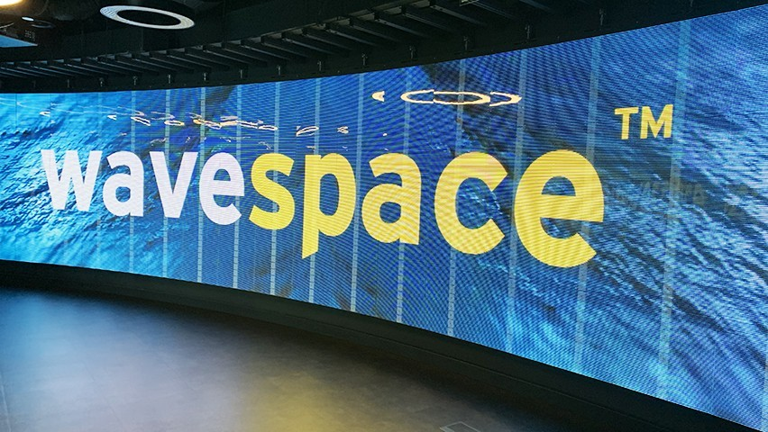 Photo of digital Wavespace sign from EY's Madrid office.