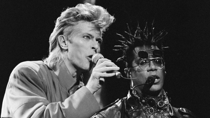 Carlos Alomar plays guitar on stage with David Bowie