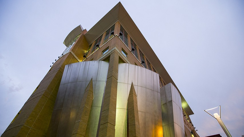 The Babbio Center, on the Stevens campus, looking up at twilight.