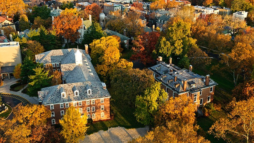 The Stevens campus from overhead. The trees have turned orange and yellow in the fall.