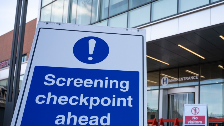 Hospital with sign indicating disease screening checkpoint
