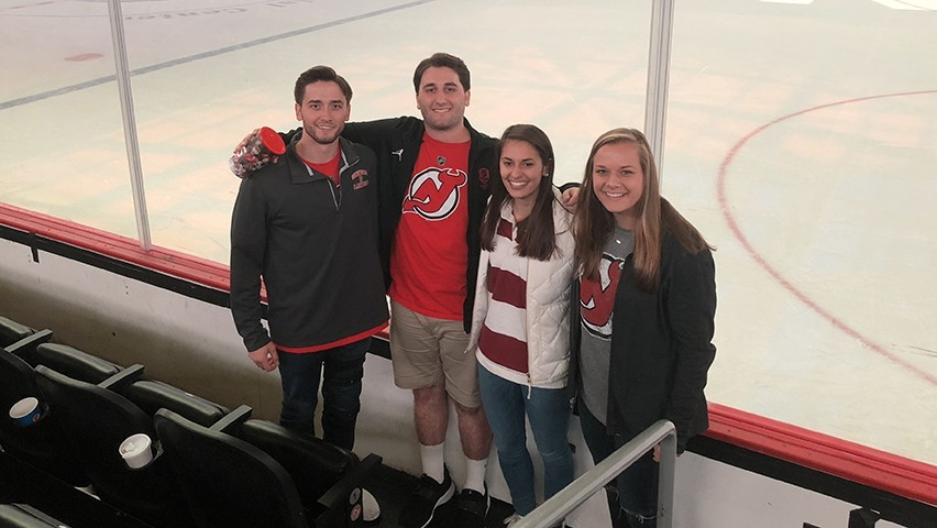 Four Stevens seniors in front of the ice at the Prucential Center in Newark.