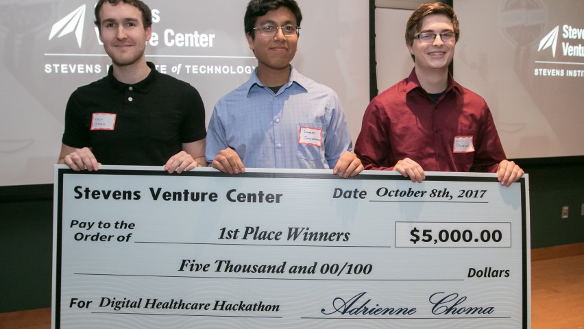 Hackathon winners Team Ethyl display ceremonial check. From left: Ryan O'Shea, Sharan Juangphanich and Chris Blackwood.