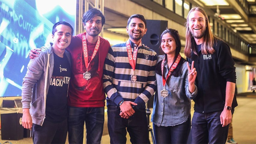 The three winners and two judges pose for a group photo after the hackathon.