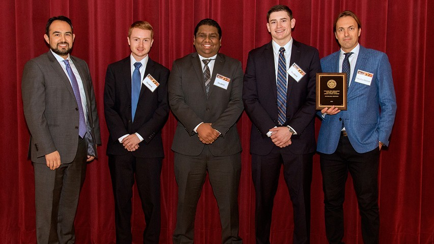 The Fed Challenge team accepts its honorable mention award.