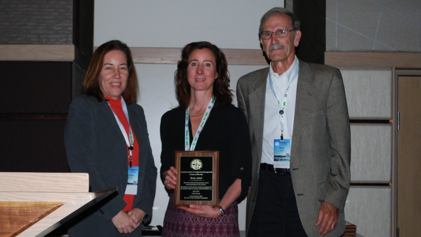 Photo of Kathryn Abel receiving her fellowship from ASEM.