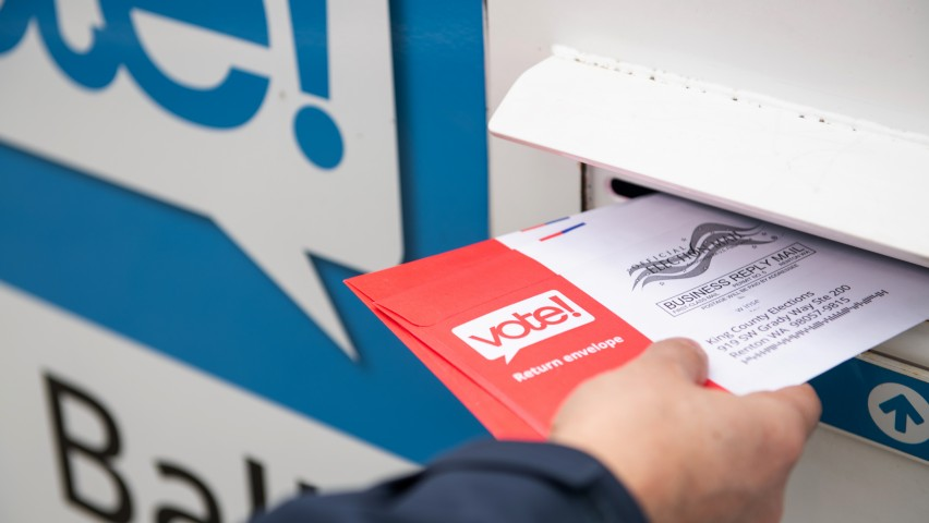 Person mailing an election ballot
