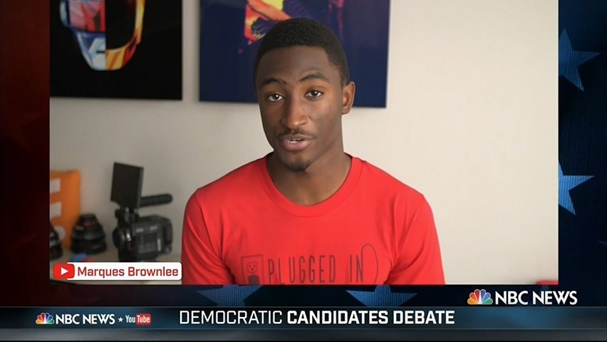 A screenshot of Marques Brownlee asking a question of Democratic presidential candidates during a debate.