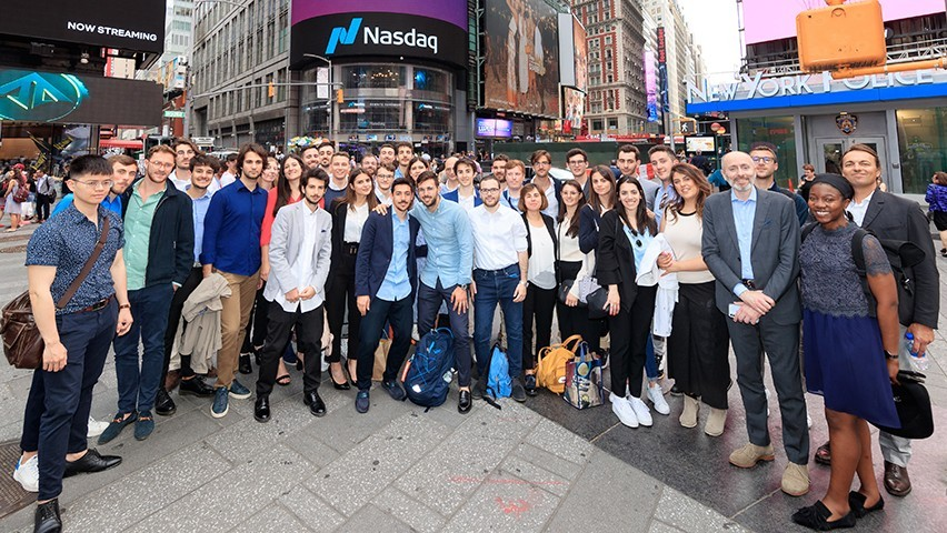 Students standing in Times Square during a visit to the offices of Nasdaq.