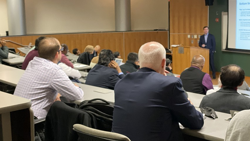 Photo of Tom Doughty from Prudential Financial presenting in a lecture hall during FinCyberSec2019.