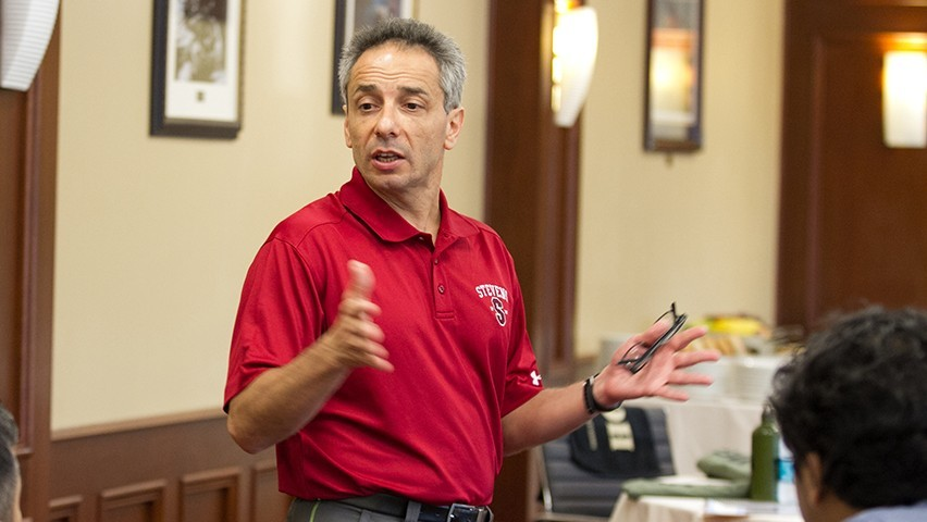 Dr. Peter Dominick teaching in a corporate boardroom in the Thayer Hotel, in West Point, NY.