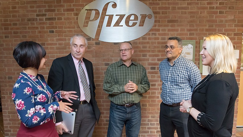 Pfizer employees and Stevens faculty discussing an assignment at Pfizer's Peapack offices.