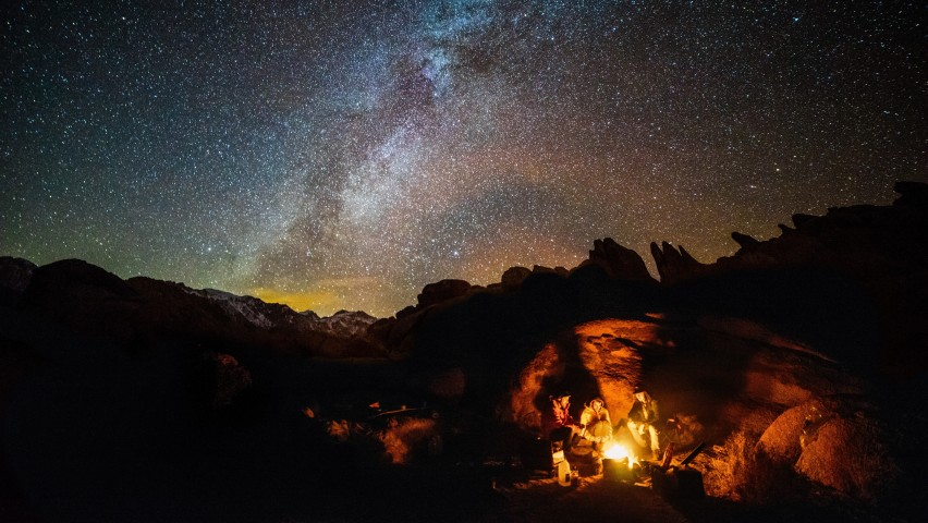 photo of people camping under the stars