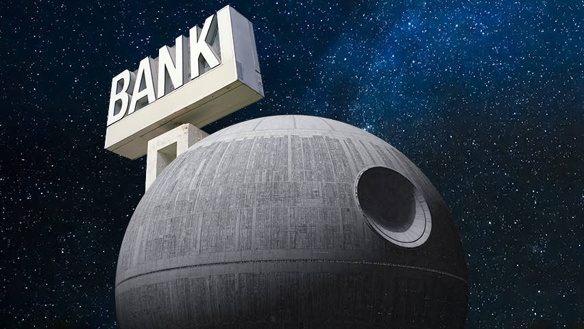 The Death Star against a night sky with a bank sign on it.