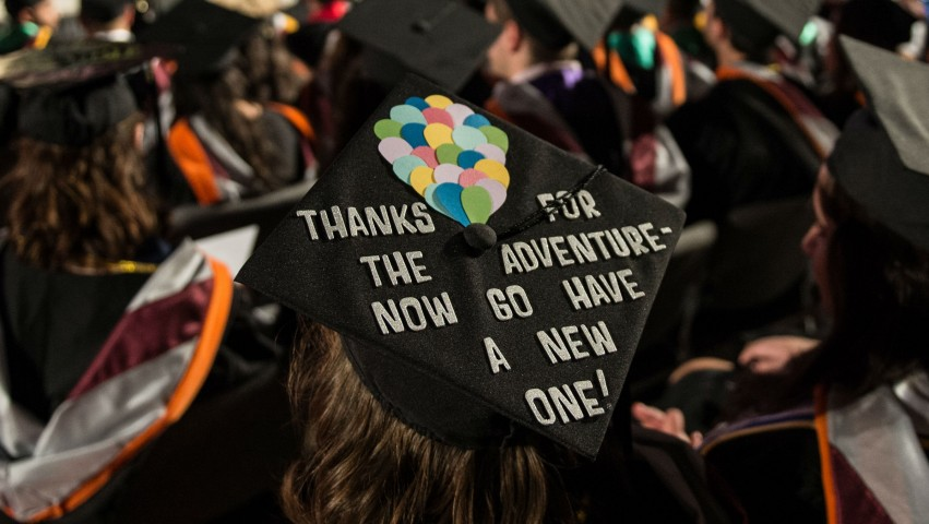 Undergraduate commencement cap that reads: Thanks for the adventure, now go have a new one!