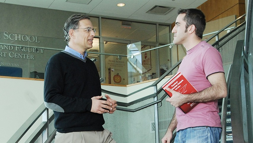 Zvi Aronson speaking with a graduate student at the School of Business.