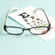 photo of glasses and eye exam chart