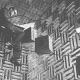 Historic photo of a researcher at Bell Labs in their anechoic chamber