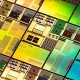 A close-up studio photo of rainbow-colored iridescent silicon computer wafers. Chips like these are increasingly designed through artificial intelligence.